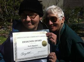 Ruth (left) displays her award.